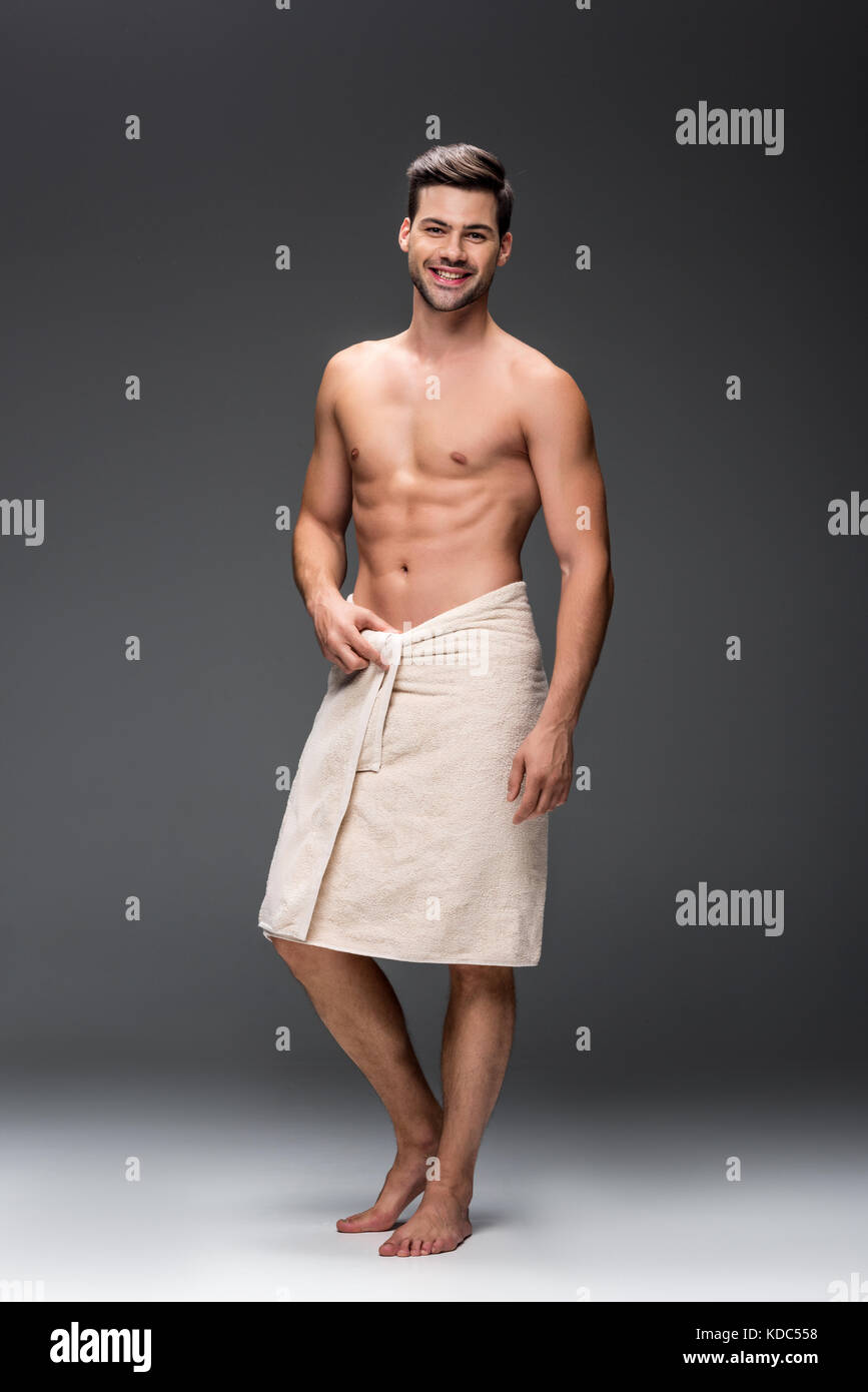 man covering with towel after shower - Stock Image