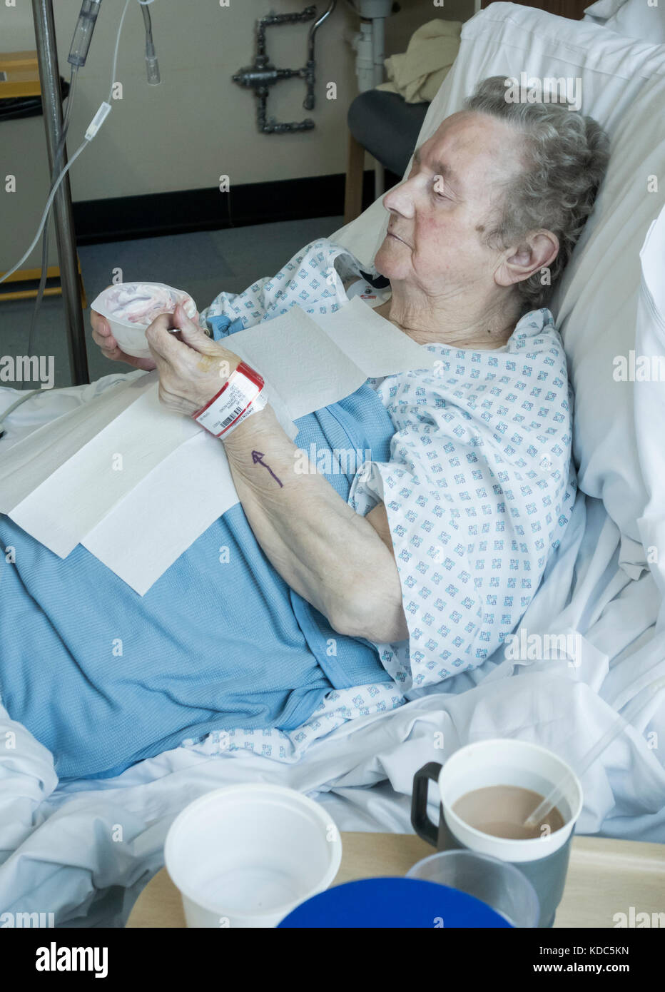 90 year old woman eating in bed in NHS hospital. England. UK - Stock Image