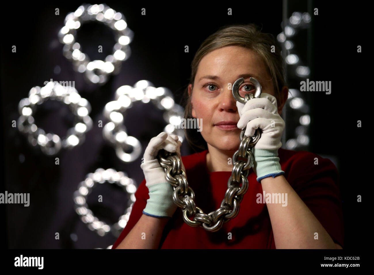 Research fellow Alice Blackwell takes a closer look at a Pictish neck chain during an exhibition to showcase the - Stock Image