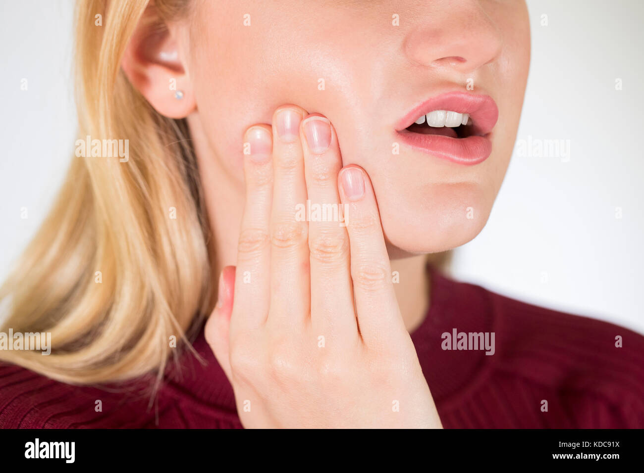 Studio Close Up Of Woman Suffering With Toothache - Stock Image