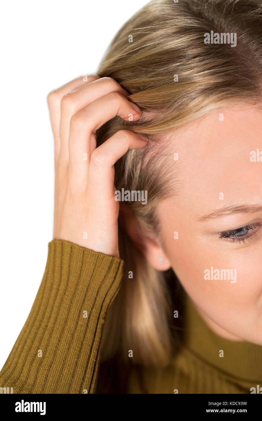 Studio Shot Of Young Woman Itching Scalp Stock Photo