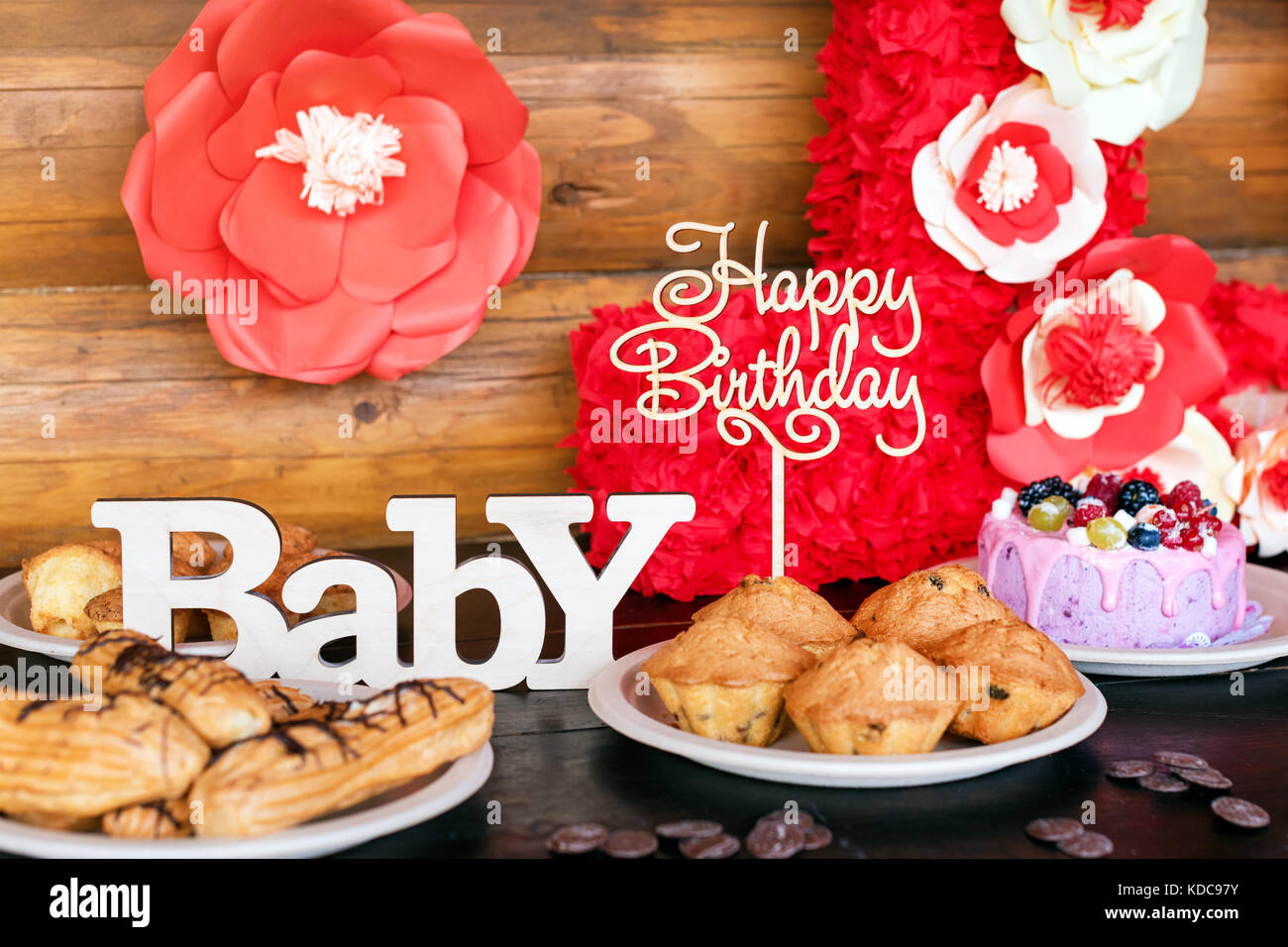 Birthday Cakes And Muffins With Wooden Greeting Signs On Rustic Background Sing Letters Happy Baby Holiday Sweets