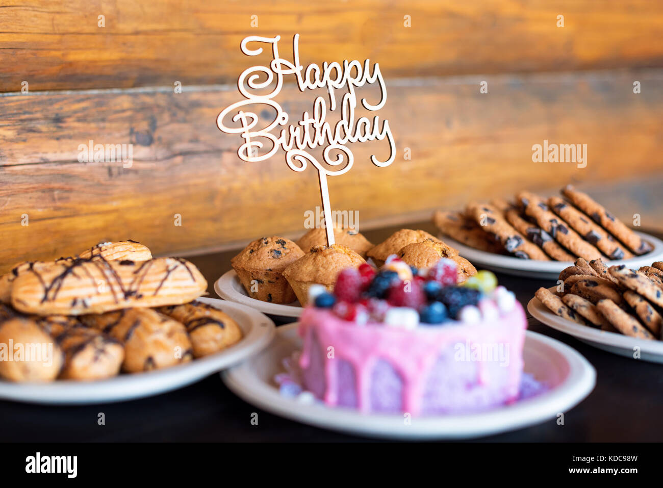 Birthday Cake And Muffins With Wooden Greeting Sign On Rustic Stock