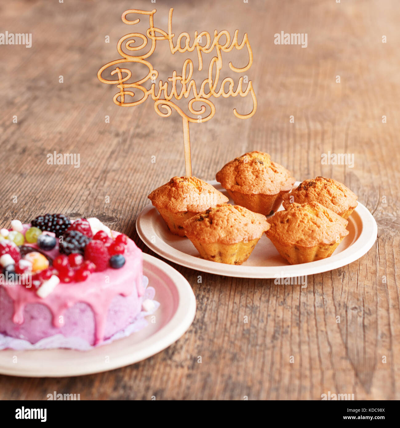 Birthday Cake And Muffins With Wooden Greeting Sign On Rustic Background Sing Letters Happy Holiday Sweets
