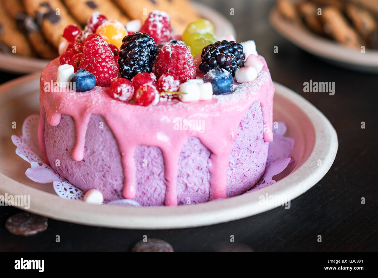 Sweet cheese cake with fresh berries and yoghurt cream. Delicious raspberry cake with fresh strawberries, raspberries, Stock Photo