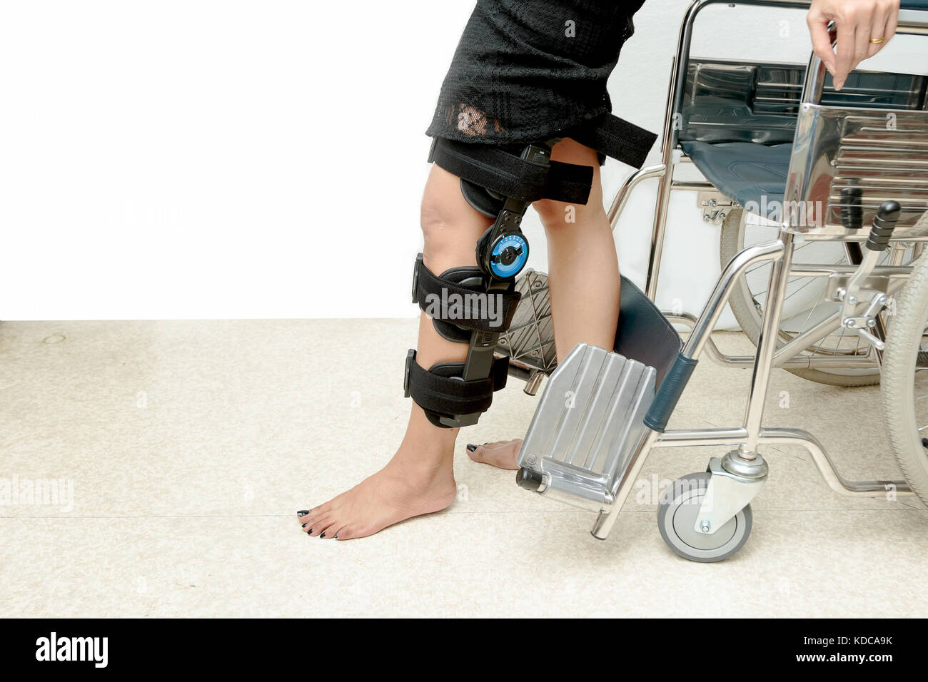 Patient on knee brace support try to walk training,Rehabilitation treatment - Stock Image