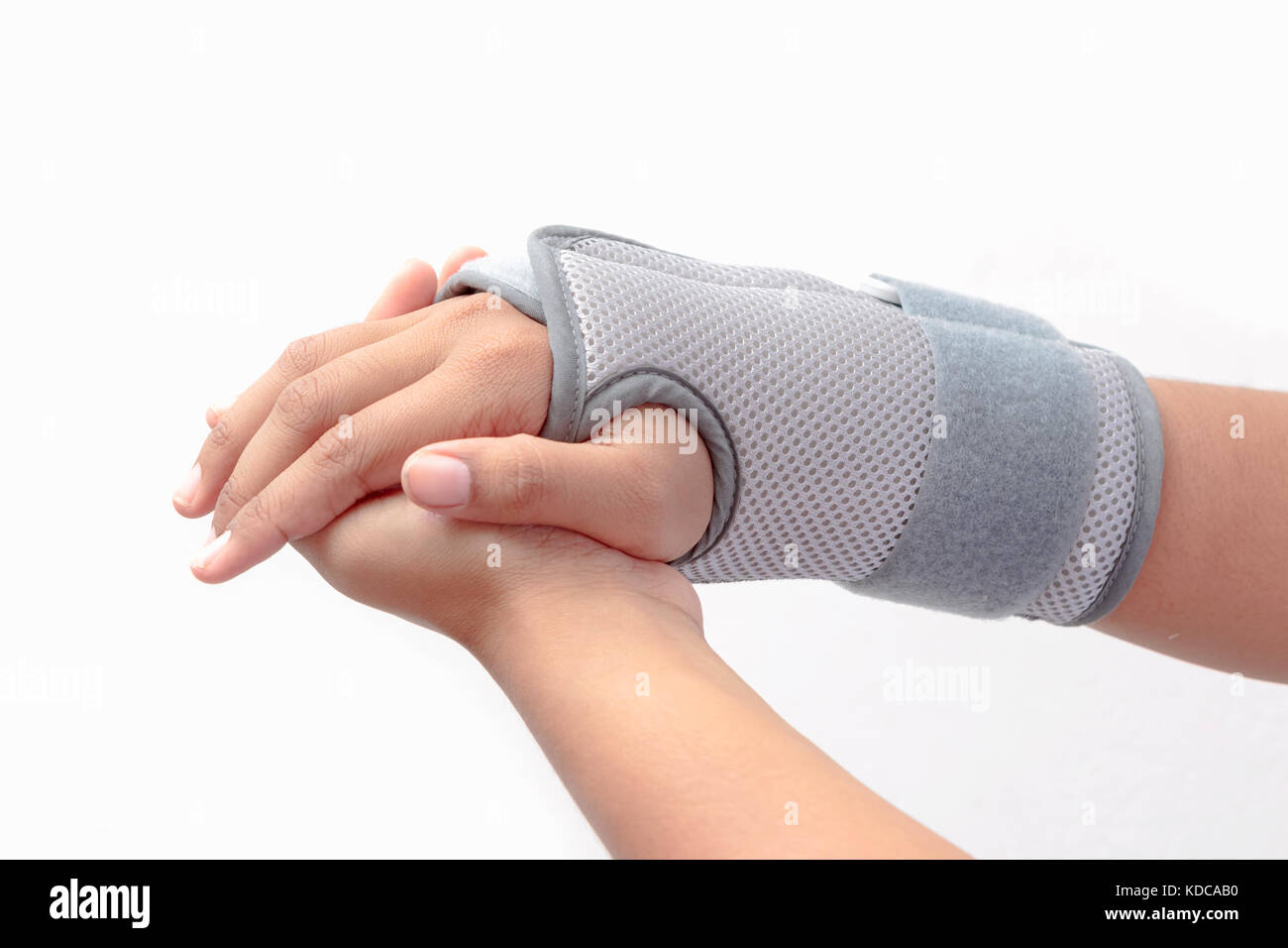 Woman's hand with wrist orthosis on white background - Stock Image