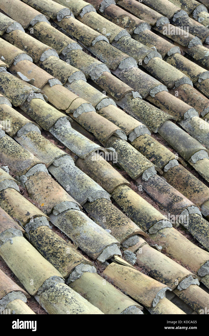 rows and lines or tiers of roofing tiles laid in a symmetrical pattern on the roof of greek farmhouse or barn. pan - Stock Image