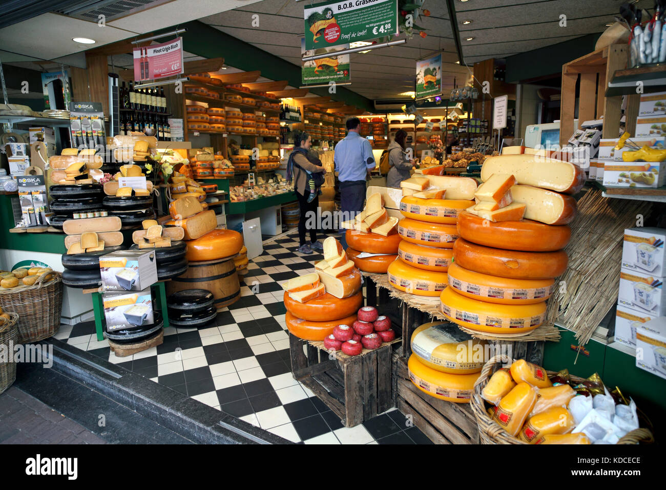 Cheese wheels on display outside the Kaashuis Tromp cheese shop, Haarlem, The Netherlands - Stock Image
