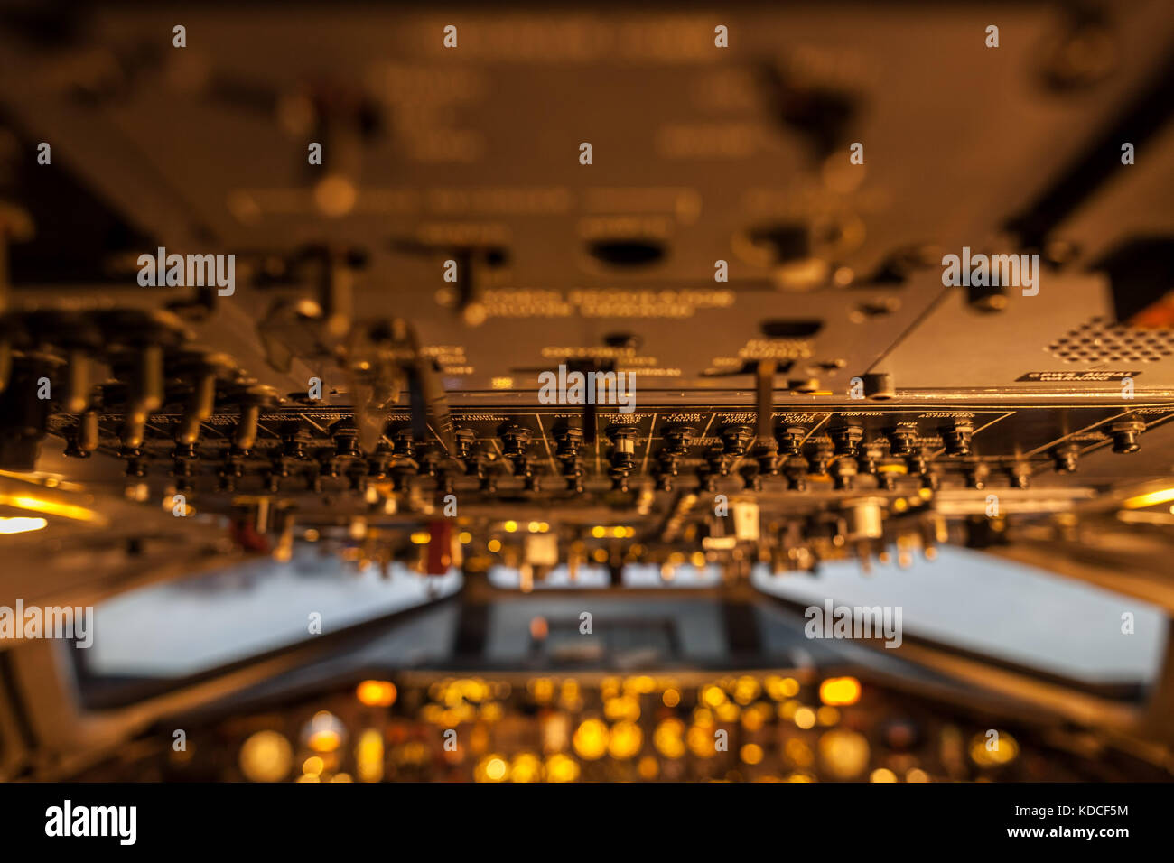 A lot of control levers in aircraft cockpit with selective focus - Stock Image