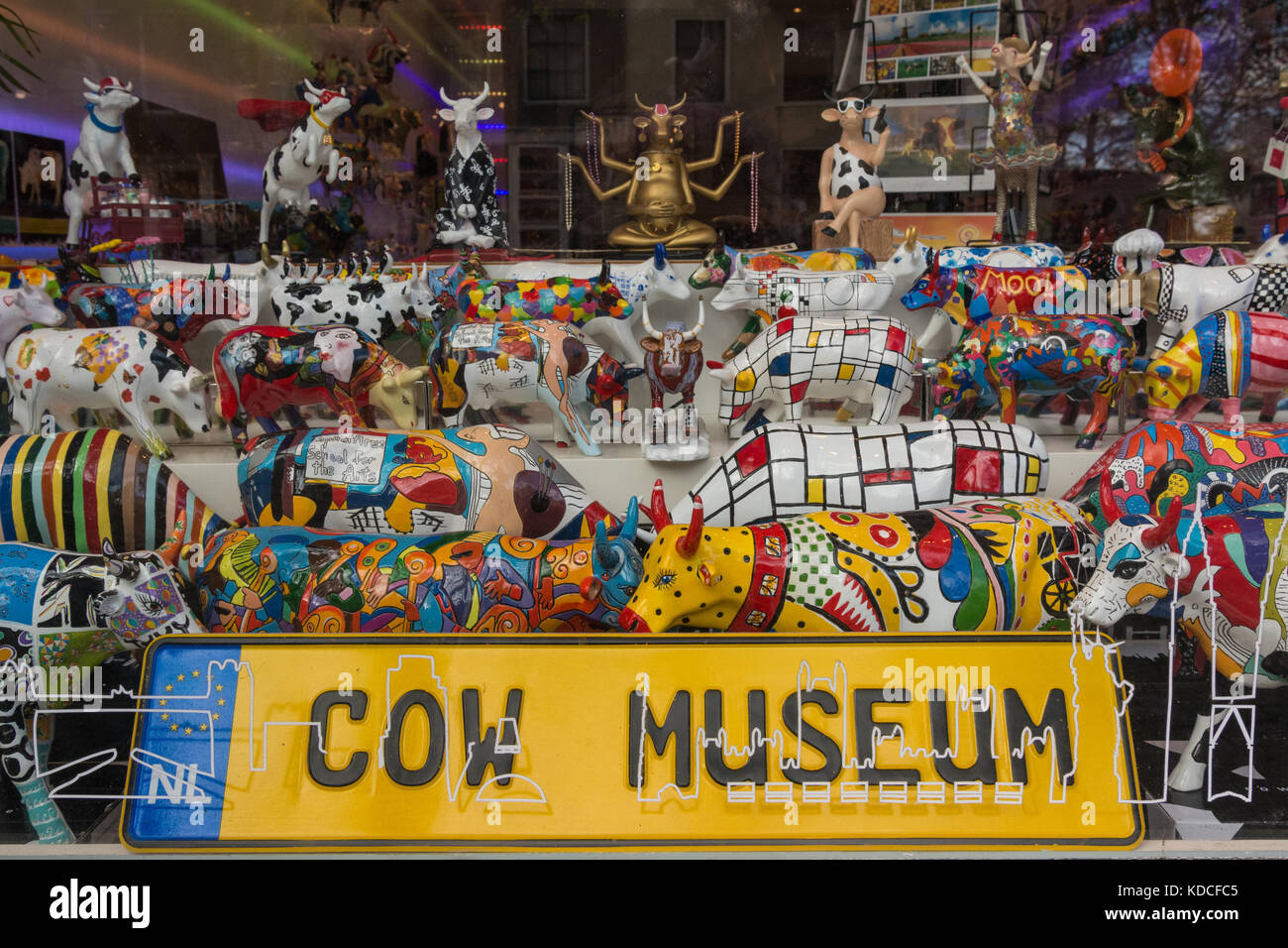 Amsterdam shop window - although the sign says 'Cow Museum' this is a shop selling eccentric cow shaped - Stock Image