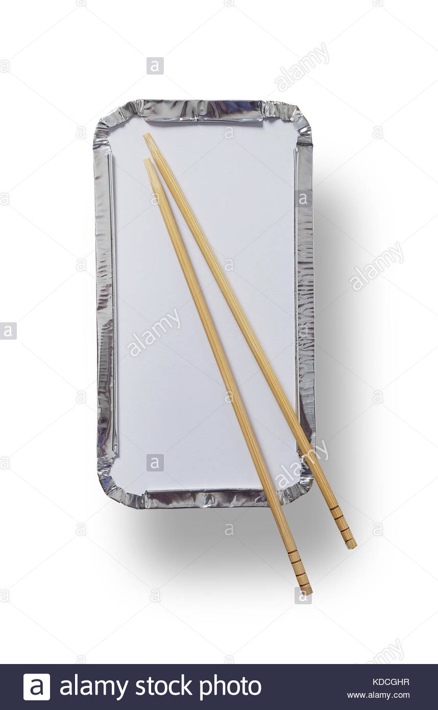 Silver foil takeaway tray with chopsticks placed on top shot from above isolated on white with path - Stock Image
