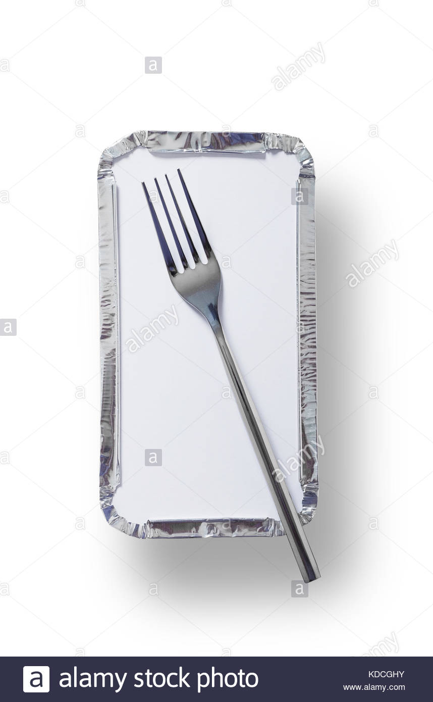 Silver foil takeaway tray with a fork placed on top. Shot from above isolated on white with path - Stock Image