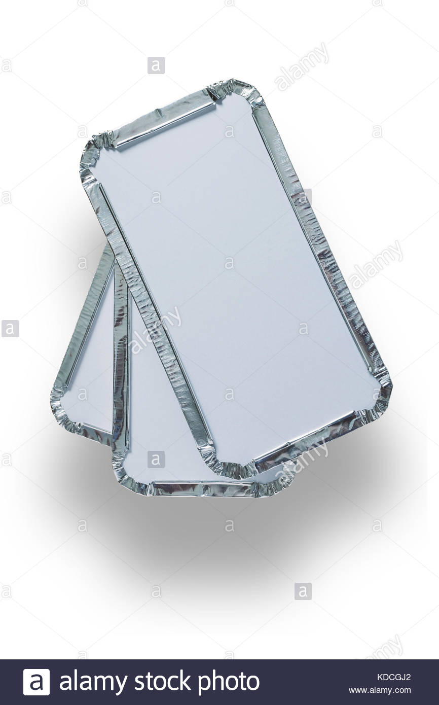 Pile of three silver foil takeaway trays shot from above isolated on white with path - Stock Image