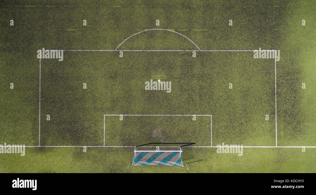 View of a football pitch with blue and white goals from above. - Stock Image