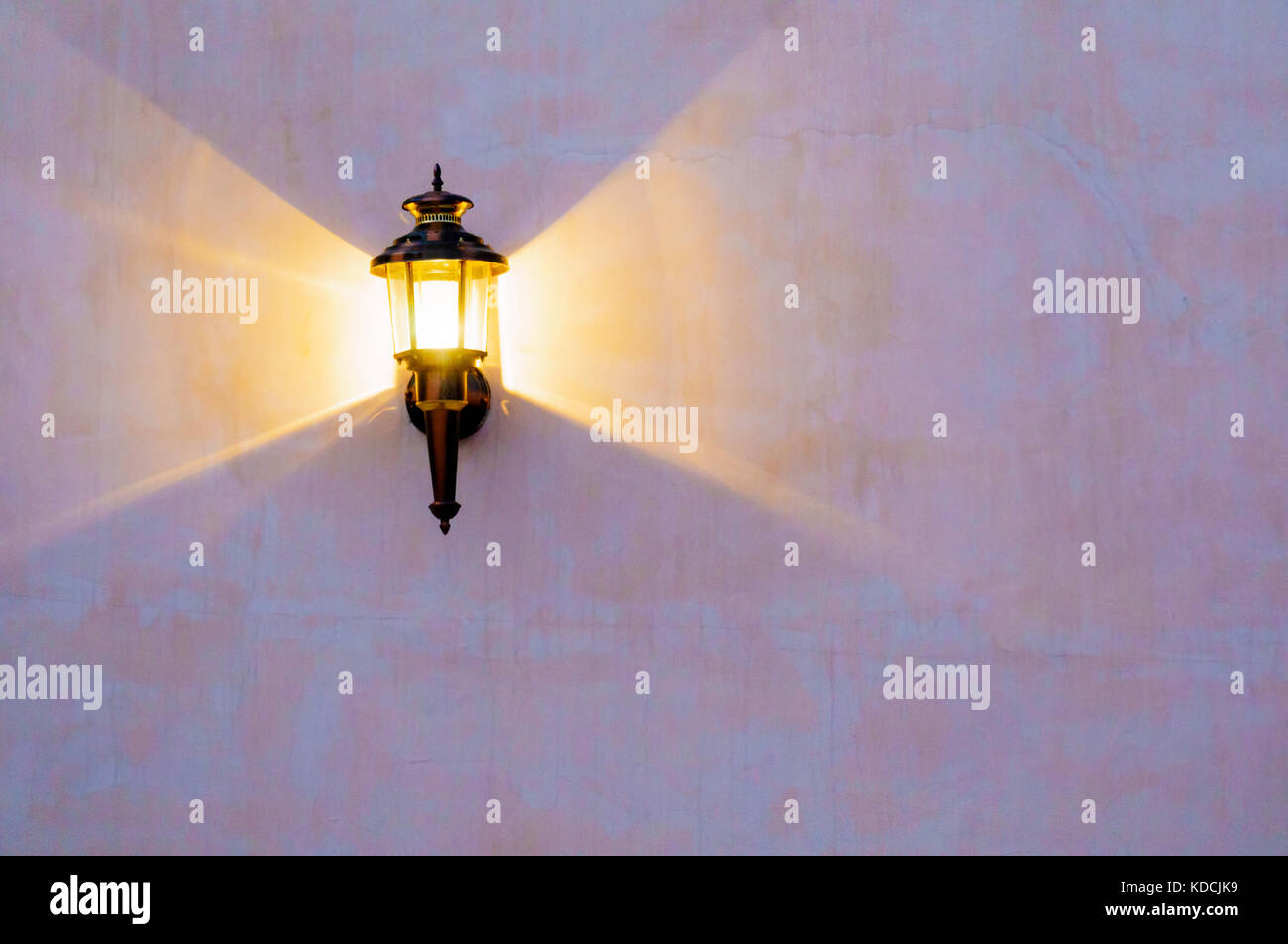 Elegant old fasioned metal lamp throwing triangles of light on a - Stock Image