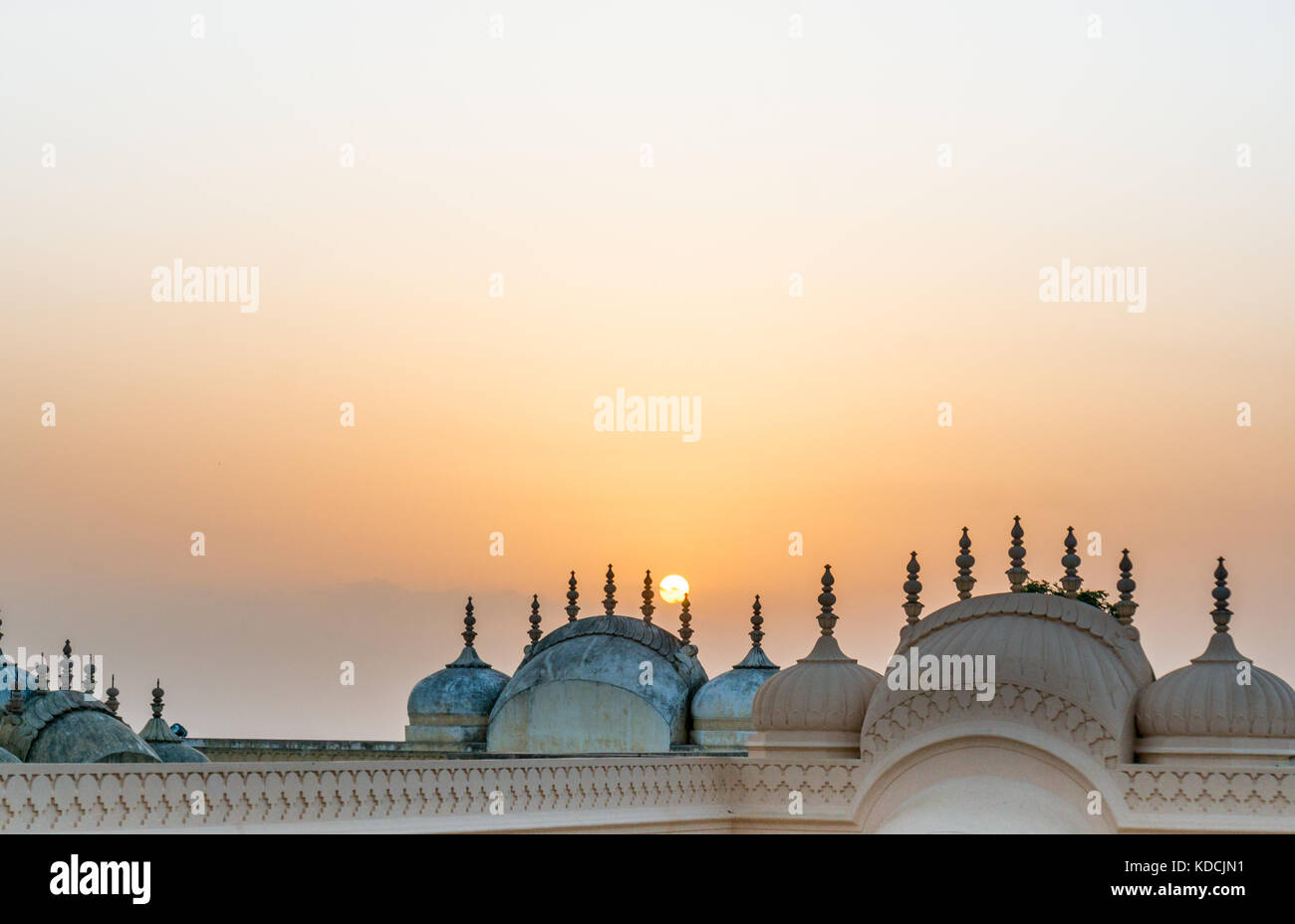 Domes and spires of Nahargarh fort shot against the setting sun  - Stock Image