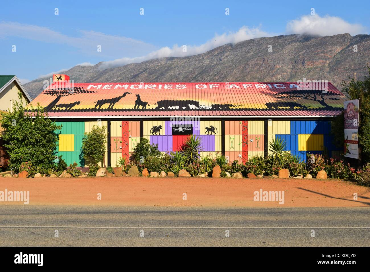 Colorful shop decorated with African wildlife silhouette, located in mountainous Klein Karoo and Overberg region, - Stock Image