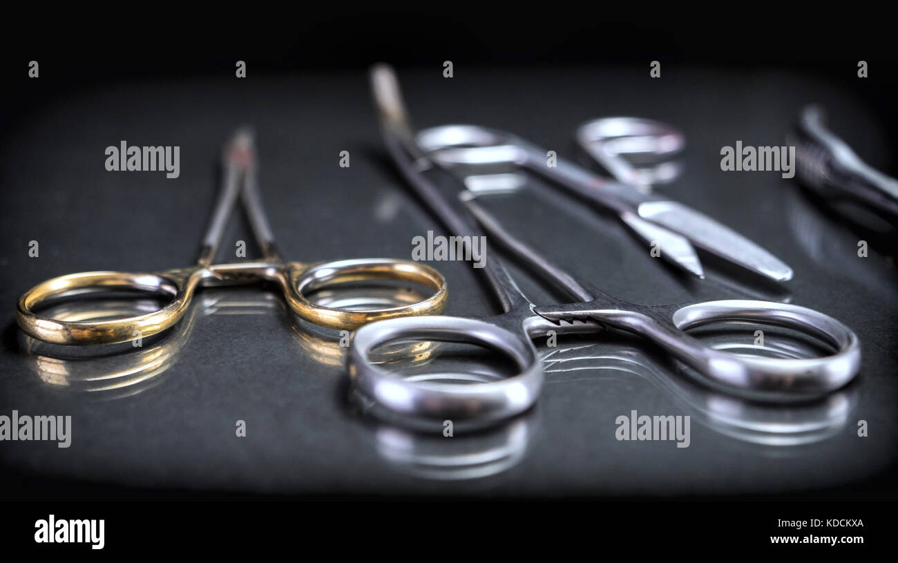 Several scissors operating theater aligned - Stock Image