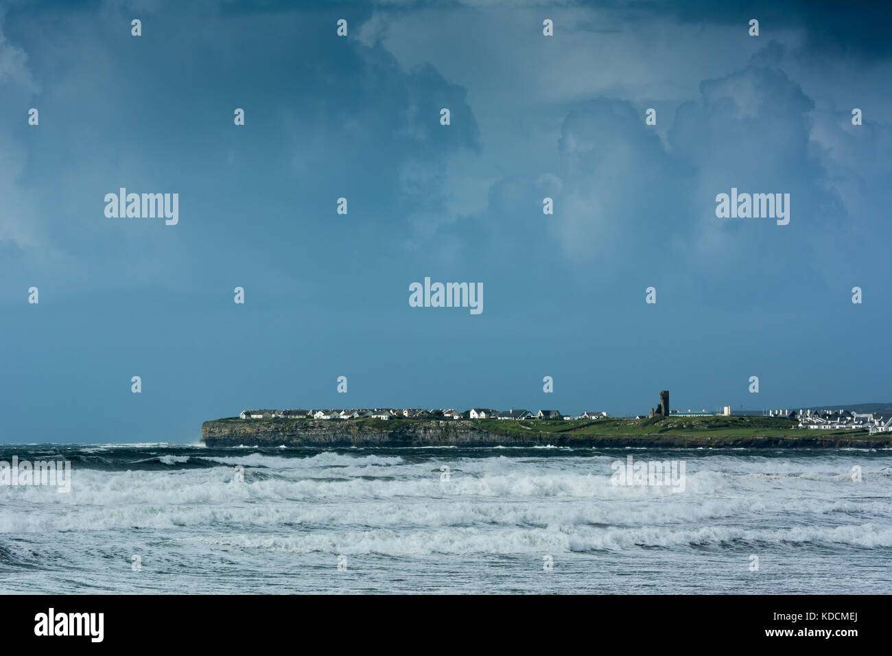 View of stormy sea and clouds towards Liscannor from Lahinch beach in County Clare on the Atlantic west coast of - Stock Image
