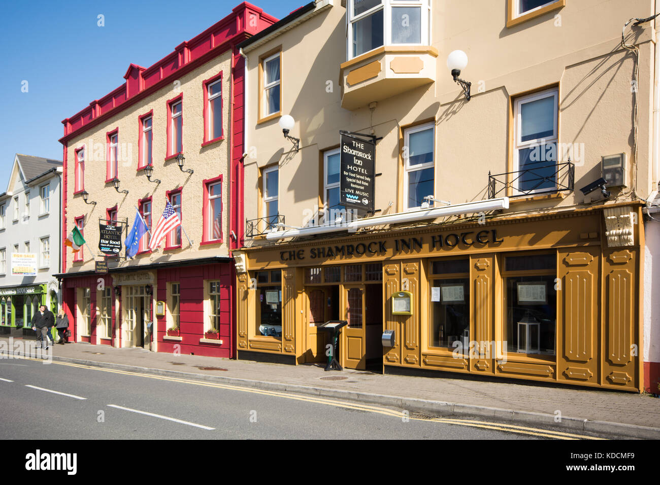 The Shamrock Inn and Atlantic hotels on the main street of Lahinch in county Clare on the Wild Atlantic Way on the - Stock Image