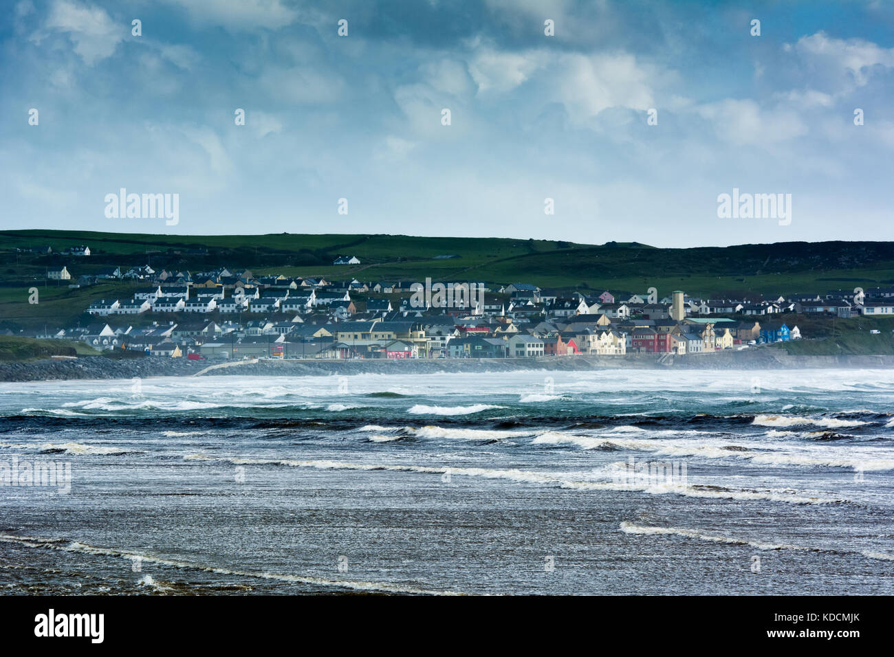 View of the colourful town of Lahinch across Liscannor Bay along the Wild Atlantic Way in county Clare on the west - Stock Image