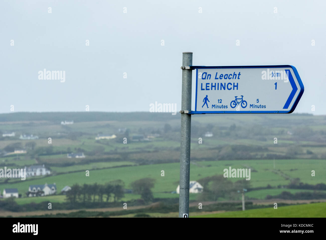 Signpost for walking and cycle ways through the west of Ireland landscape at Lahinch (Lehinch) in County Clare - Stock Image