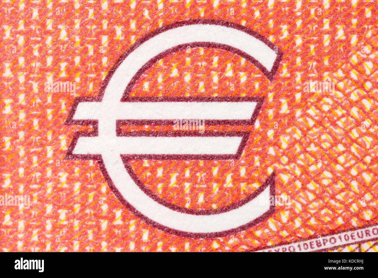 Euro symbol on red background. - Stock Image