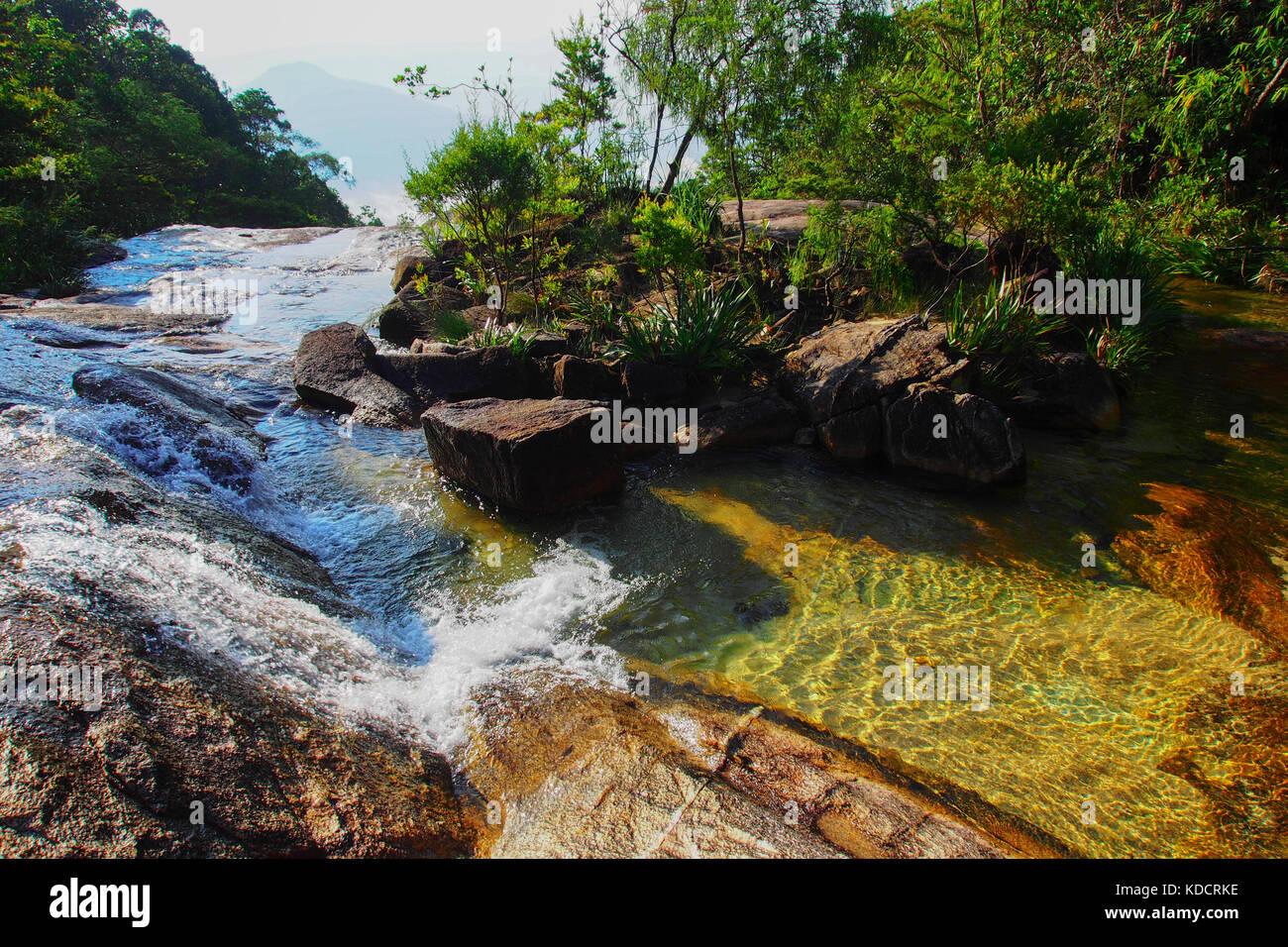 Flowing water in Tropical rainforest, Chemerong Berembun Langsir, CBL, malaysia - Stock Image