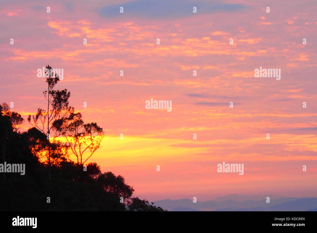 sunrise view at chemerong berembun langsir campsite, CBL, malaysia - Stock Image