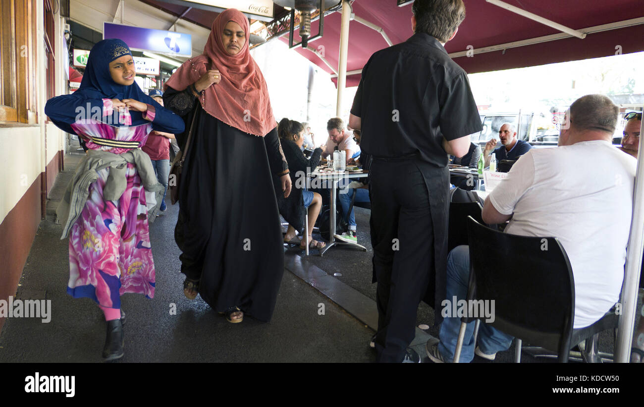 Two Women Wearing Hijab Walk In Italian Neighborhood Carlton Stock Photo Alamy