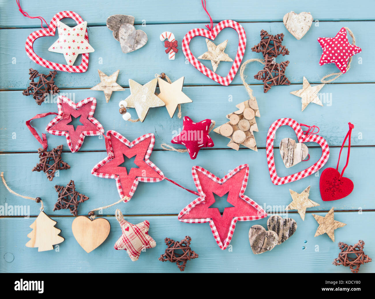 Rustic christmas decorations and ornaments on blue wooden background Stock Photo