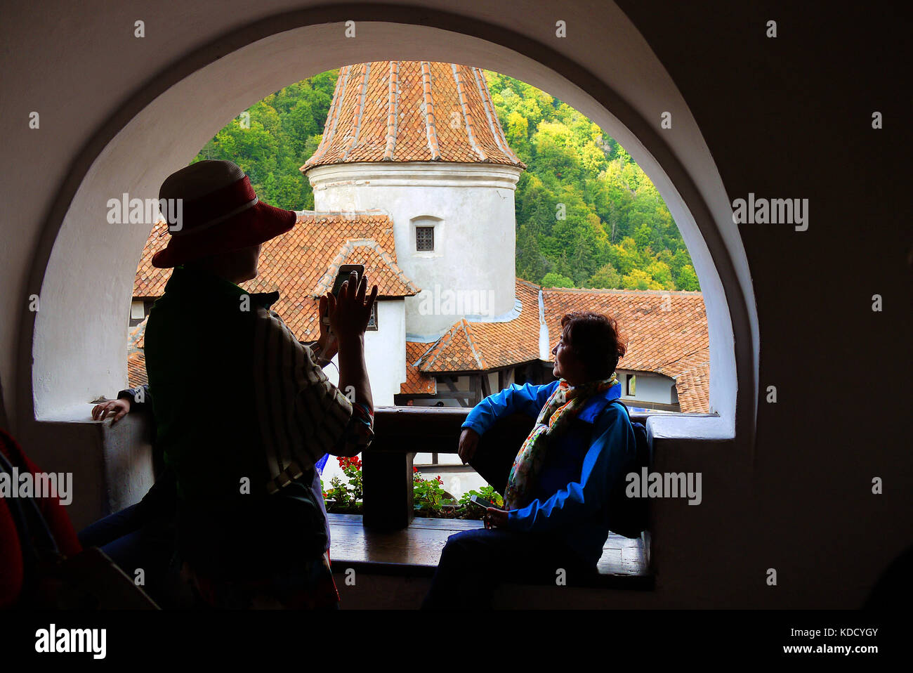 Tourists taking photographs with a smartphone at Bran Castle, Bran, Brasov, Romania. - Stock Image