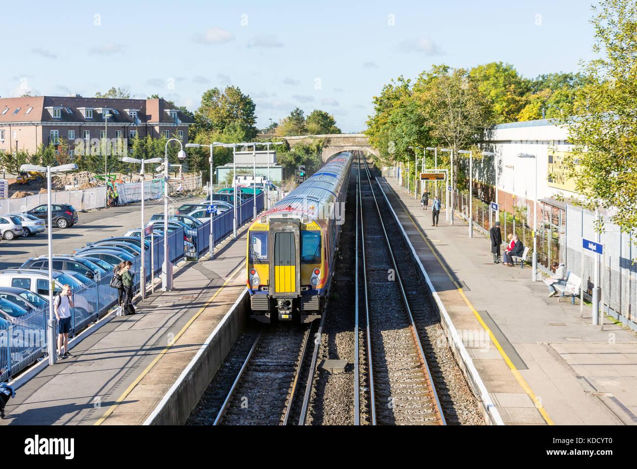 South West Train leaving Ashford Railway Station, Ashford, Surrey, England, United Kingdom - Stock Image