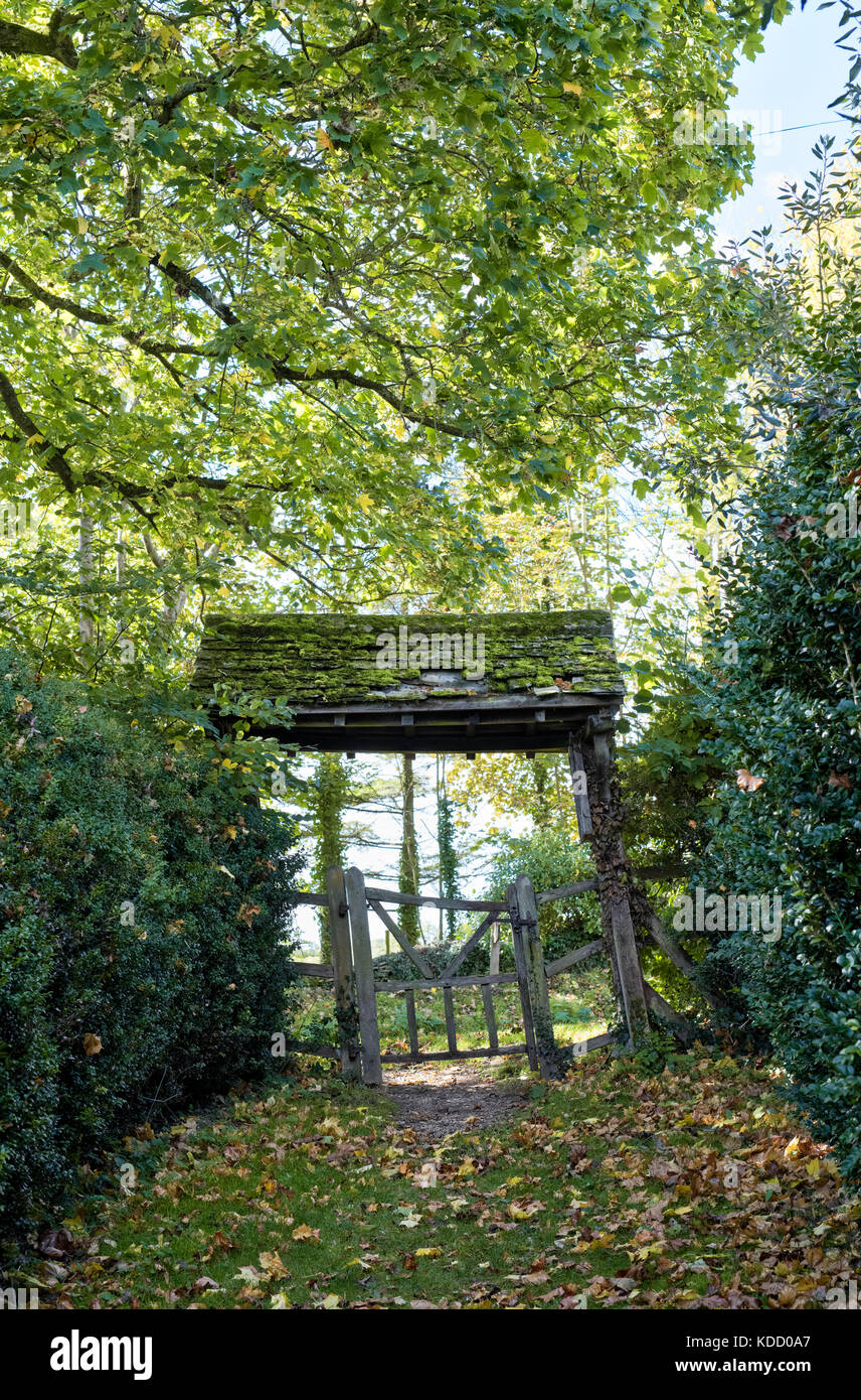 St. Michaels saxon church old wooden lychgate at Duntisbourne rouse, Cotswolds, Gloucestershire, England - Stock Image