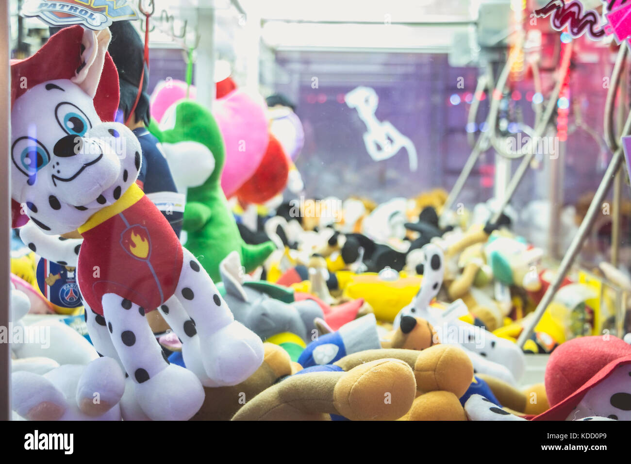 SABLES D OLONNE, FRANCE - November 27, 2016: In a traditional funfair a claw machine allows to win stuffed animals - Stock Image