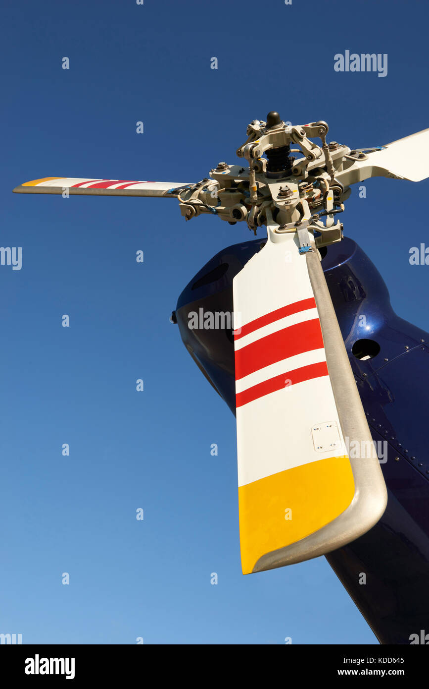 Tail Rotor Of Helicopter Against Blue Sky - Stock Image