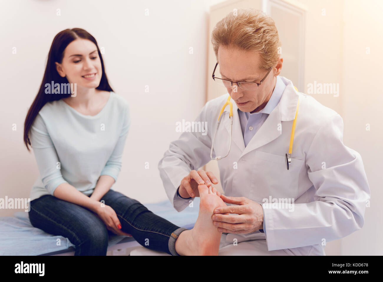 Pretty patient sitting in consulting room - Stock Image
