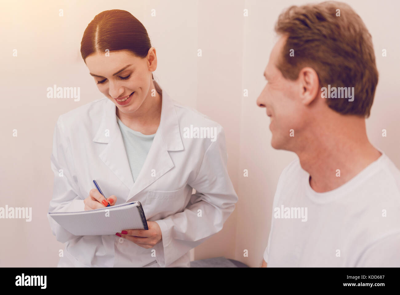 Attentive young doctor making notes Stock Photo