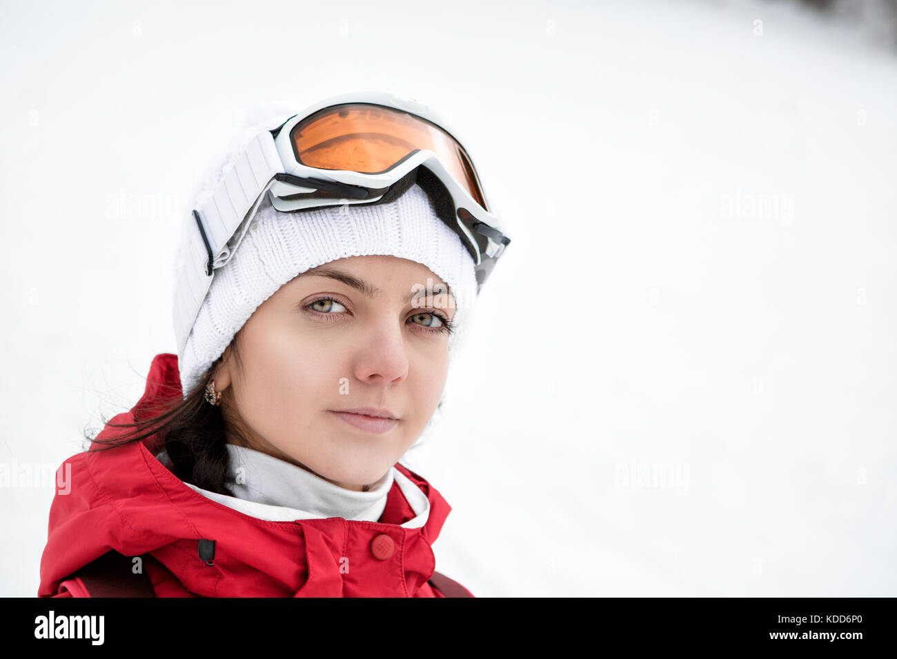 Portrait of a skier woman in ski goggles  - Stock Image
