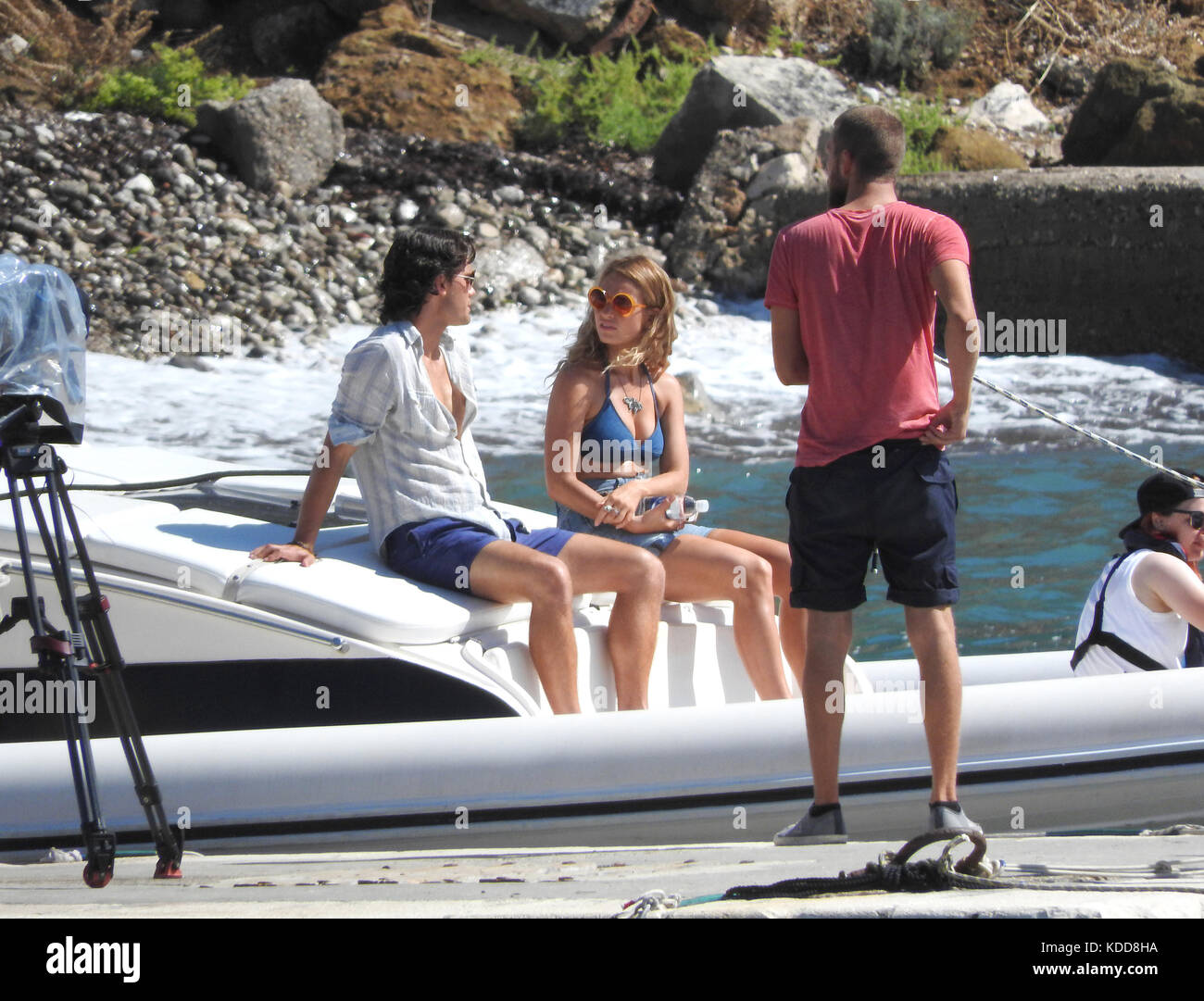 c21ac4bb83 Jeremy Irvin and Lily James sit on the edge of a boat as they film scenes