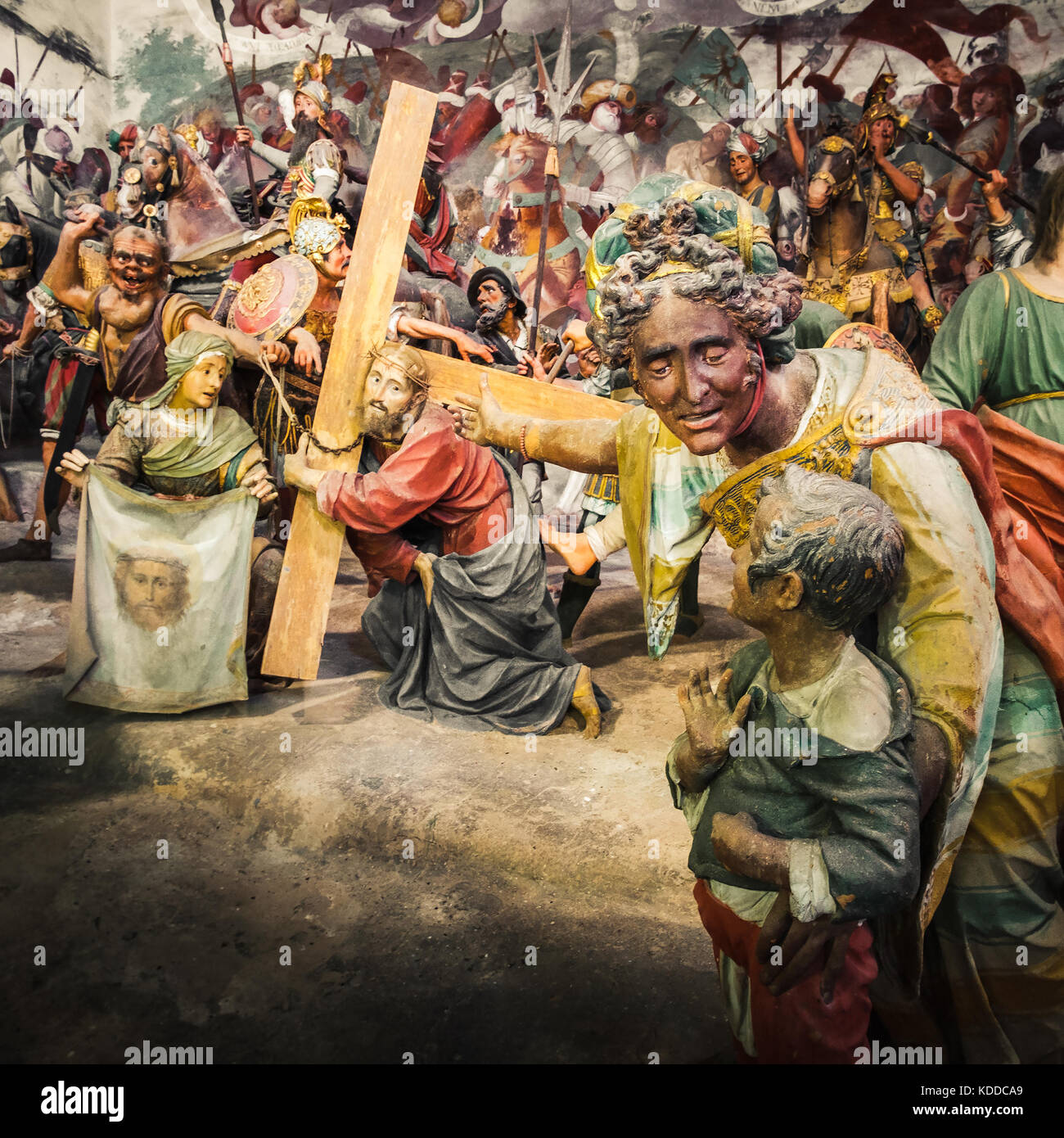 Via Crucis of Jesus Christ, in a Passion of Christ biblical scene a woman show his child a Jesus Christ bringing - Stock Image