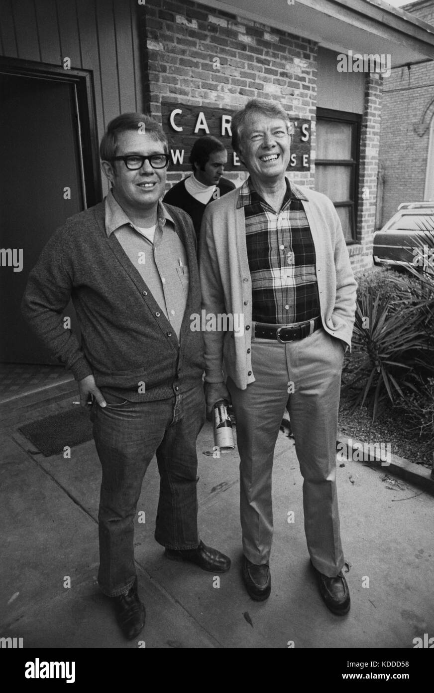 Jimmy Carter and brother Billy Carter outside the family agricultural warehouse in Plains, Georgia. - Stock Image
