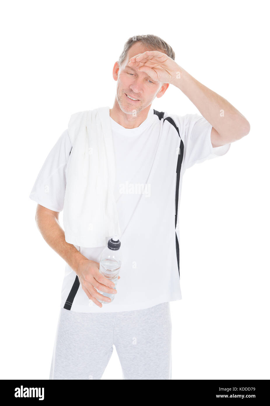 Tired Mature Man Wiping Sweat Holding Water Bottle - Stock Image