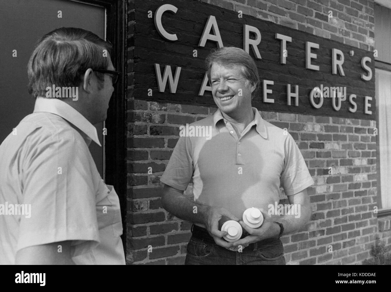 Jimmy Carter and his brother Billy outside the office of the family business - Carter's Warehouse - in Plains, - Stock Image