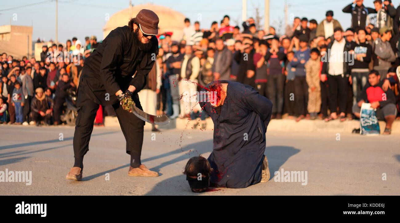EDITORS NOTE: GRAPHIC CONTENT. Undated ISIS propaganda image showing the beheading of a blasphemer by sword during Stock Photo