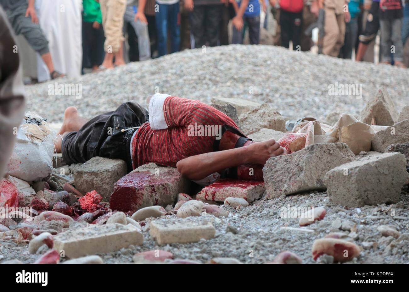EDITORS NOTE: GRAPHIC CONTENT. Undated ISIS propaganda image showing a man killed by stoning for sodomy during a Stock Photo