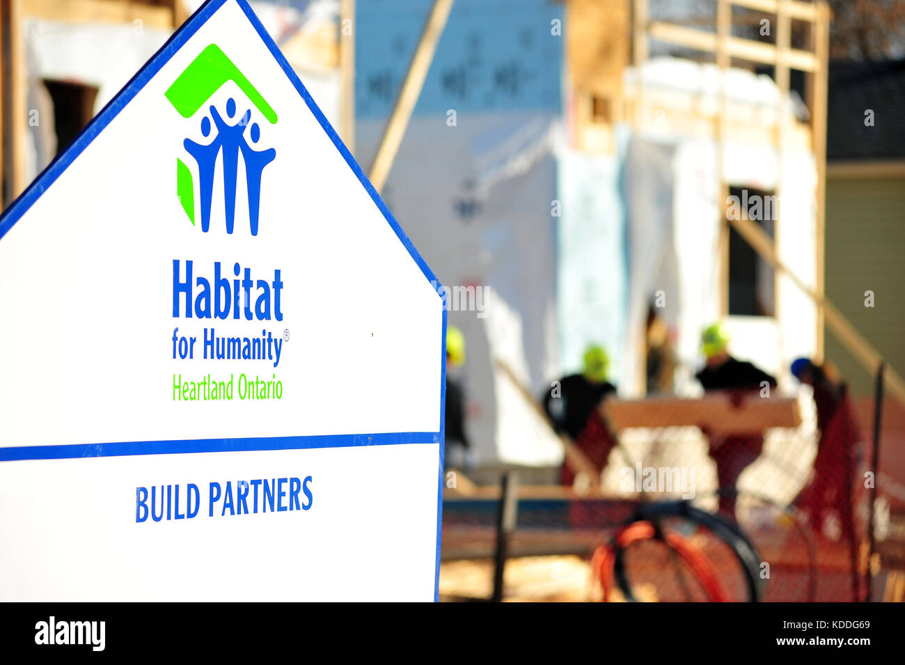 A Habitat for Humanity sign outside a build site in Ontario - Stock Image