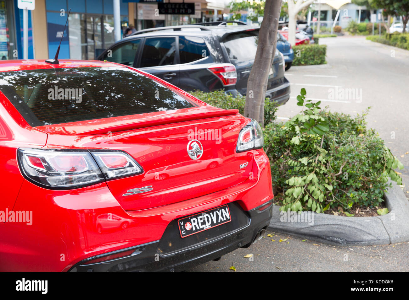 Rear boot of Holden SS Commodore saloon car in red,Forster,Australia - Stock Image