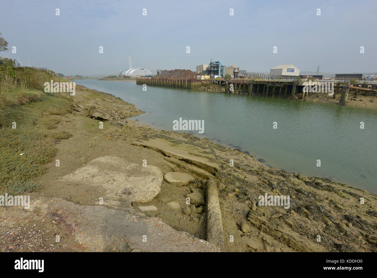 River Ouse at Newhaven, East Sussex, showing industrial buildings including household waste incinerator. - Stock Image